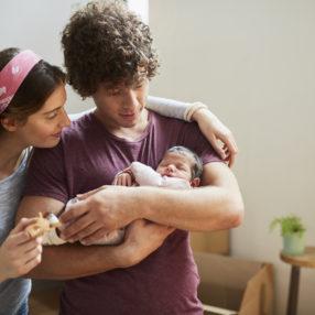 paternidad igualdad en el despacho . Millennial Parents moving to a new flat. Lifestyle shot in real location, Spain.